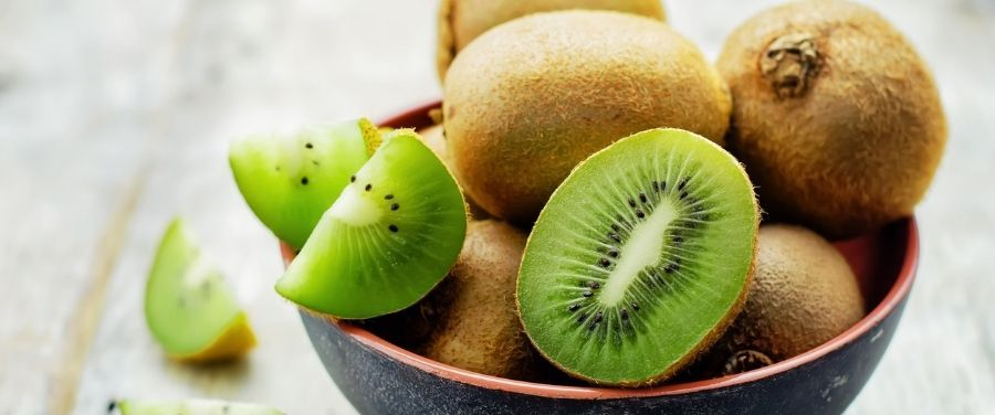 Kiwi Fruit and Its Slices Kept in A Bowl