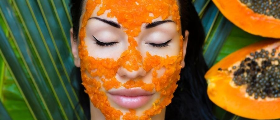 Woman Applying Papaya Face Mask