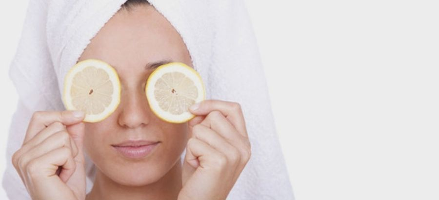Women Applying Lemon Face Mask