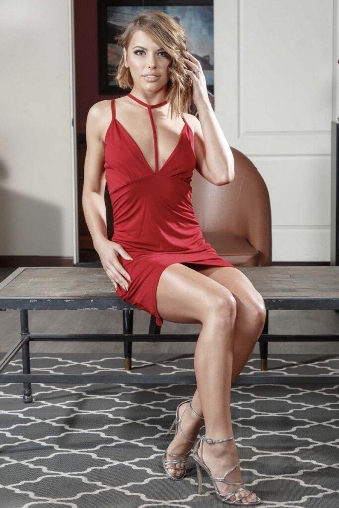Adriana Chechik Posing In Red Dress